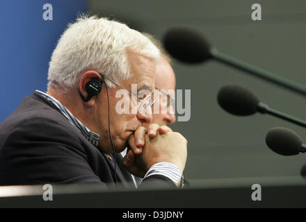 (dpa) - US architect Peter Eisenman wears a set of headphones as he stits next to the President of the German Bundestag - Stock Photo