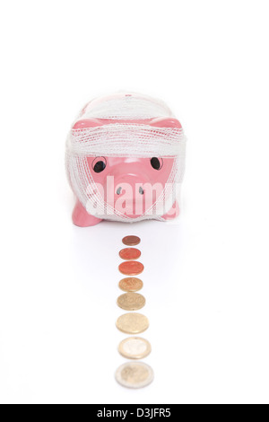saving in piggy bank for health care concept - Stock Photo