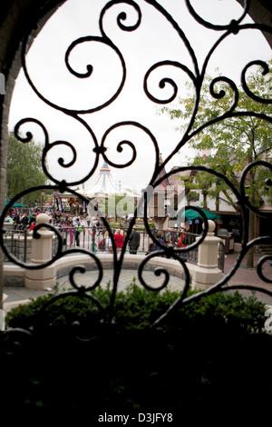 View of the main street in Disney land Paris through a window - Stock Photo
