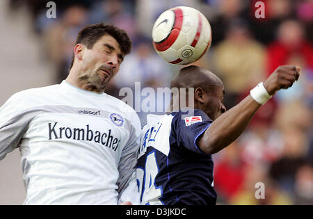 (dpa) - Berlin's Nando Rafael (R) and Bielefeld's Petr Gabriel fight for the ball during the game between Hertha - Stock Photo