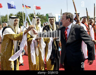 (dpa) - German Chancellor Gerhard Schroeder is greeted by a group of sabre dancers prior to the laying of the foundation - Stock Photo