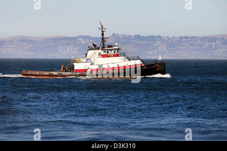 Fishing a vessel in waters in a gulf of silent ocean of San Francisco - Stock Photo