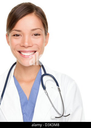 Portrait of multiracial Asian / Caucasian female medical professional smiling isolated on white background - Stock Photo