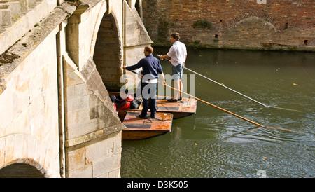 Two punts going under a bridge on the River Cam [The Backs] Cambridge Cambridgeshire England Europe - Stock Photo