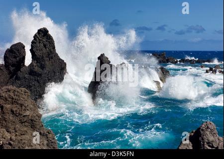 Waves crashing on volcanic rocks. Laupahoehoe Point Beach Park. Hawaii, the big Island. - Stock Photo