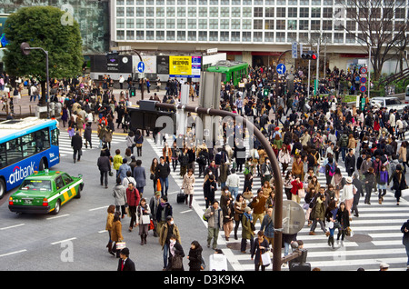 Shibuya Scramble Crossing as seen from the popular Starbucks, Tokyo, Japan - Stock Photo