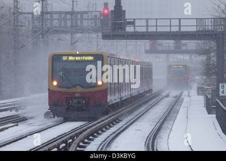 Berlin, Germany, S-Bahn trains in snow on snow-covered tracks - Stock Photo