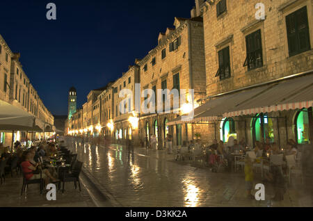 Stradun, the main street of the old city of Dubrovnik in Croatia, taken at late evening. Tourists enjoying themselves - Stock Photo