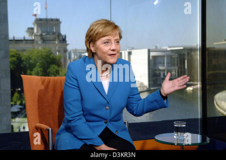 (dpa) - The picture shows Angela Merkel, chairwoman of the Christian Democratic Union (CDU) and candidate for the German chancellorship during a TV interview at the ARD studio in Berlin, Germany, Thursday 18 August 2005. German TV station MDR produced the interview, which will will be broadcasted tonight. With the so-called 'candidate checks', MDR starts its reporting on the Federa