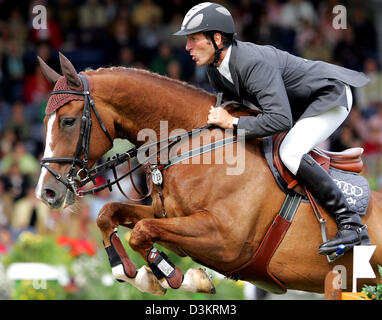 (dpa) - German equestrian Ludger Beerbaum jumps over a barrier on his horse L'Espoir during the  CHIO International - Stock Photo