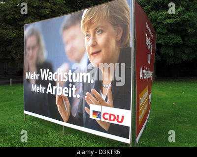 (dpa) - Angela Merkel, chairwoman of the Christian Democratic Party (CDU) and her party's top candidate for the chancellorship in Germany, is featured on an election poster of the CDU, which reads 'More growth, more jobs',  ahead of the general elections for the German Bundestag parliament on 18 September 2005, pictured in the state of North Rhine Westphalia, Germany on 23 August 2