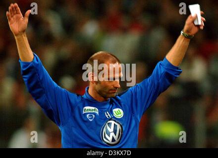 (dpa) - VfL Wolfsburg's Head Coach Holger Fach celebrates his team's triumph over Bundesliga rival Hanover 96 at - Stock Photo