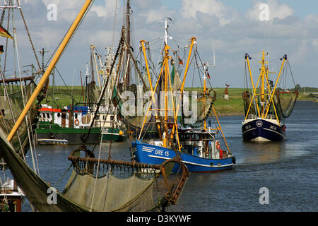 (dpa) - The picture dated 04 August 2005 shows the harbour of the East Frisian city of Greetsiel, Germany. Photo: - Stock Photo