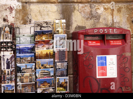 (dpa) - The picture shows a picture postcard rack next to a letterbox in Rome, Italy, 01 October 2005. Photo: Lars - Stock Photo