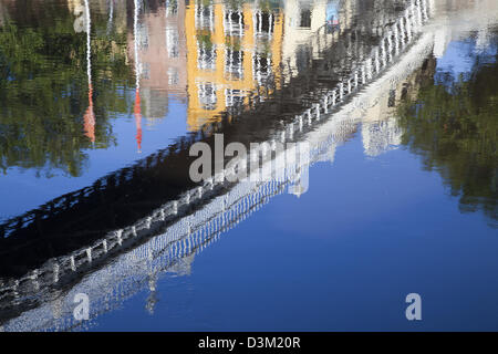 Reflection of Ha'penny Bridge in the River Liffey, Dublin city, County Dublin, Ireland. - Stock Photo