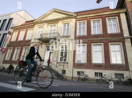(dpa files) - A cyclist rides pass the Pablo Picasso graphics museum in Muenster, Germany, 26 October 2005. Photo: - Stock Photo