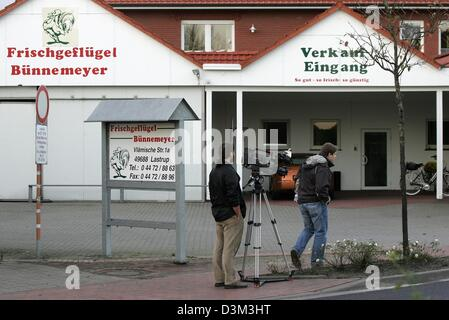 (dpa) - Two television journalists stand with their camera in front of the  completely deserted premises of the - Stock Photo
