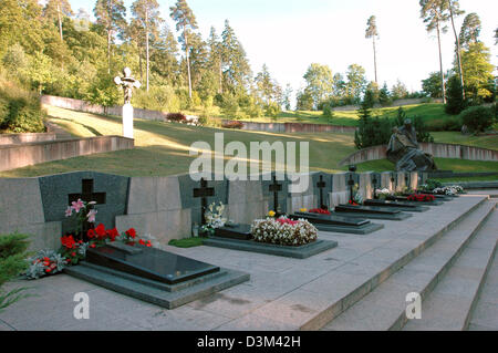 (dpa) - The graves and crosses mark the place where some of the people were laid to rest, who died in the struggle - Stock Photo