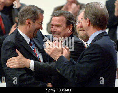 (dpa) - German Chancellor Gerhard Schroeder (C) congratulates the just elected chairman Matthias Platzeck (L) at - Stock Photo