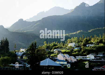 View of hillside houses from Mare a Joncs lake in the French town of Cilaos, Reunion Island, Indian Ocean - Stock Photo