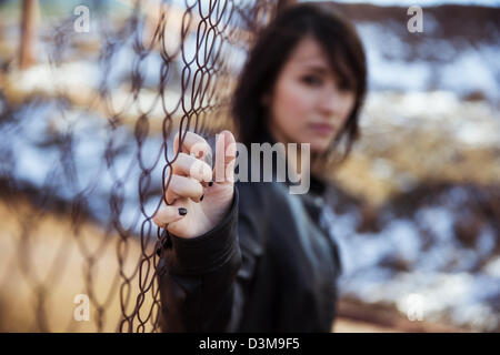 Young anonymous woman staring at camera. - Stock Photo