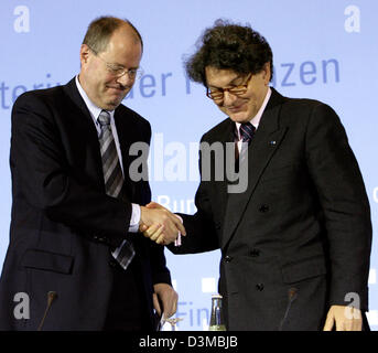 Federal Minister of Finance Peer Steinbrueck (L) and his French colleague Thierry Breton shake hands after a press - Stock Photo