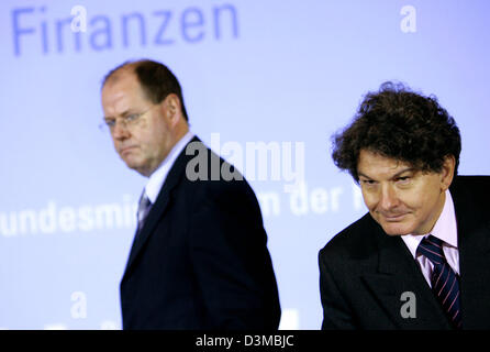 Federal Minister of Finance Peer Steinbrueck (L) and his French colleague Thierry Breton appear for a press conference - Stock Photo