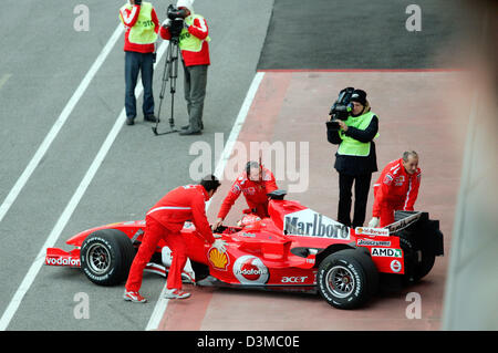 German Formula One pilot Michael Schumacher is pulled back into pits in his new 'Ferrari 248 F1' race car after - Stock Photo
