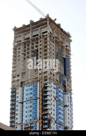 The picture shows the construction site of a high-riser at the beach of Dubai City, United Arab Emirates, 12 January - Stock Photo