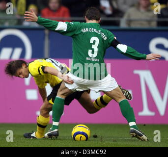 Dortmund Player Ebi Smolarek (L) vies for the ball with Wolfsburg player Peter van der Heyden after his 2-1 score - Stock Photo