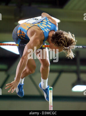 German pole vaulter Tim Lobinger jumps over the bar at the IAAF Indoor Meeting in Karlsruhe, Germany, 29 January - Stock Photo