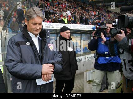 Stuttgart's new soccer coach Armin Veh (L) looks at his watch during the Bundesliga soccer match between Arminia - Stock Photo