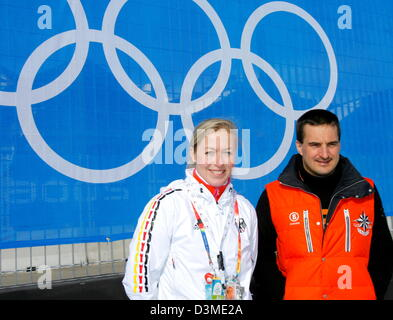 Salt Lake City Olympics luge Champions Georg Hackl (R) and Sylke Otto stand in front of the Olympic rings at the - Stock Photo