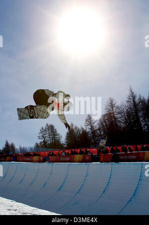 A snowboarder in action at the women's Olympic snowboard half pipe competition at the XX Olympic Winter Games in - Stock Photo