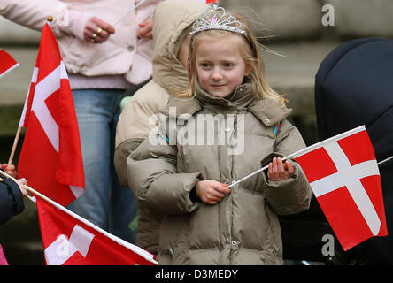 A girl with a Danish flag and a crowne waits for the arrival of Crownprince Frederick (L) and Crownprincess Mary - Stock Photo