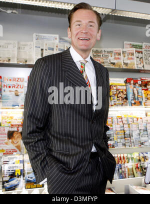 Mathias Doepfner, Chairman of Axel Springer Verlag publishing house stands in front of a set of shelves featuring - Stock Photo
