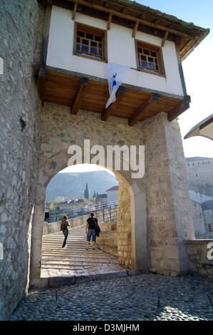 Old Bridge - built 16Th century in Mostar, Bosnia and Herzegovina. Crosses the river Neretva connects Moslems and - Stock Photo
