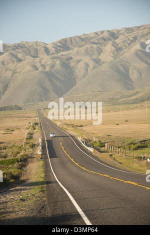 Highway One Pacific Coast road between Los Angels and San Francisco runs along the Pacific Ocean on West Coast California - Stock Photo