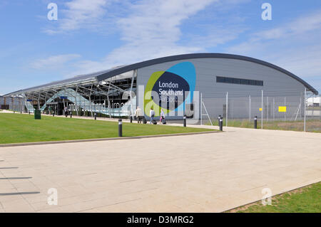 London Southend Airport terminal with passengers heading off to depart in blue skies. Space for copy - Stock Photo