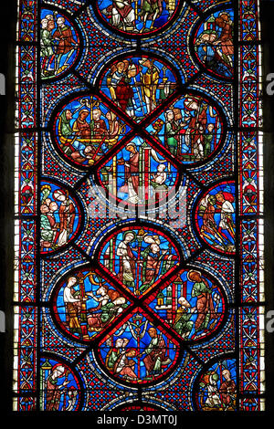 Medieval stained glass Window of the Gothic Cathedral of Chartres, France - dedicated to the Life and Miracles of - Stock Photo
