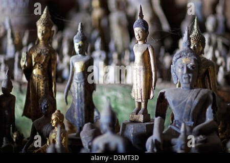 Buddha statues inside the lower cave / Tham Ting at Pak Ou Caves along the Mekong river near Luang Prabang, Laos, Southeast Asia Stock Photo