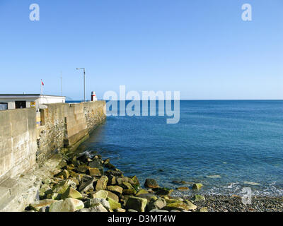 Breakwater and lighthouse - Stock Photo