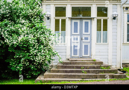 Old idyllic door and entrance to wooden house in Europe - Stock Photo