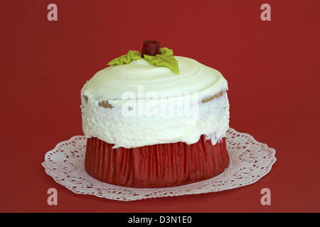 Be Mine Giant Vanilla Cupcake on doily set on red background - ideal for Valentines day, Valentine day - Stock Photo