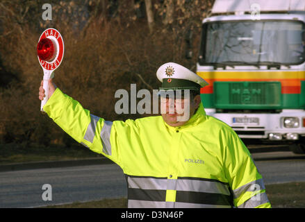 Magdeburg, Germany, traffic policeman holds up a holding trowel - Stock Photo