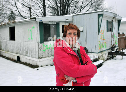 Trailer park blight, a woman with abandoned mobile home in Branford, CT USA The home will be sold at foreclosure - Stock Photo