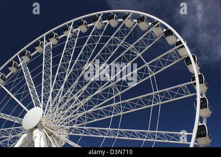 The Sky Wheel on the boardwalk in Myrtle Beach, SC USA against a blue sky. - Stock Photo