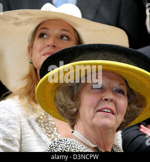 Queen Beatrix of the Netherlands (front) and Crown Princess Maxima  (back) smile during their visit to San Telmo - Stock Photo
