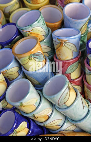 (dpa file) - The picture shows stacks of colourful ceramic cups typical for the region on sale at a local arts and - Stock Photo