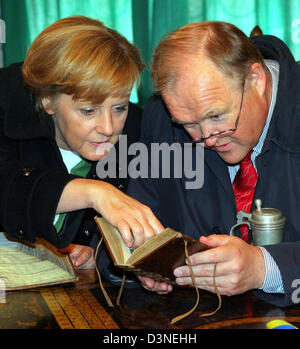 German Federal Chancellor Angela Merkel (CDU) and Swedish President Goran Persson (R) read in an antique book at - Stock Photo
